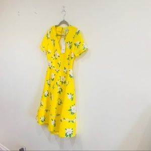 Yellow open back floral dress.